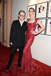 DAVID DOWNTON and ERIN O'CONNOR at a private view of fashion art by David Downton as in-house artist at Caridge's , held at Claridge's Hotel, London on 13th September 2013.