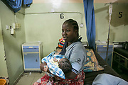 Aisha A, 28, holds her new-born baby at a hospital in Maiduguri, Nigeria, April 27, 2019. Aisha was abducted by seven BH fighters in Gwoza Local Government in 2014. After she was taken to a commander's house, she was raped by him and became the fourth wife. She stayed in his home for a year and eight months, but did not get pregnant. Aisha got pregnant by an IDP man in the same camp with whom she married, and gave birth to a boy.