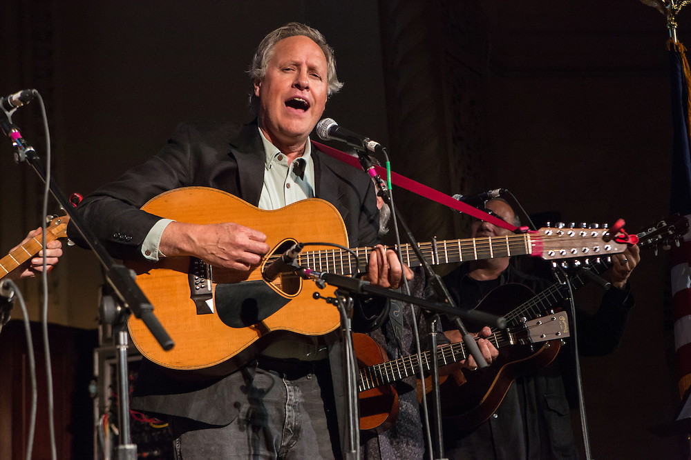Grammy award-winning musician Tom Chapin plays 12-string guitar at the concert's end. The concert was held to support a forthcoming exhibit on the folk msusic revival in New York in the 1950s and 60s.