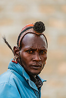 Head piece signifies this Kara tribe man as a  village elder, Dus Village, Omo Valley, Ethiopia.