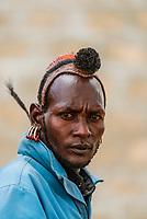 Head piece signifies this Kara tribe man as a  village elder, Dus Village, Omo Valley, Ethiopia.
