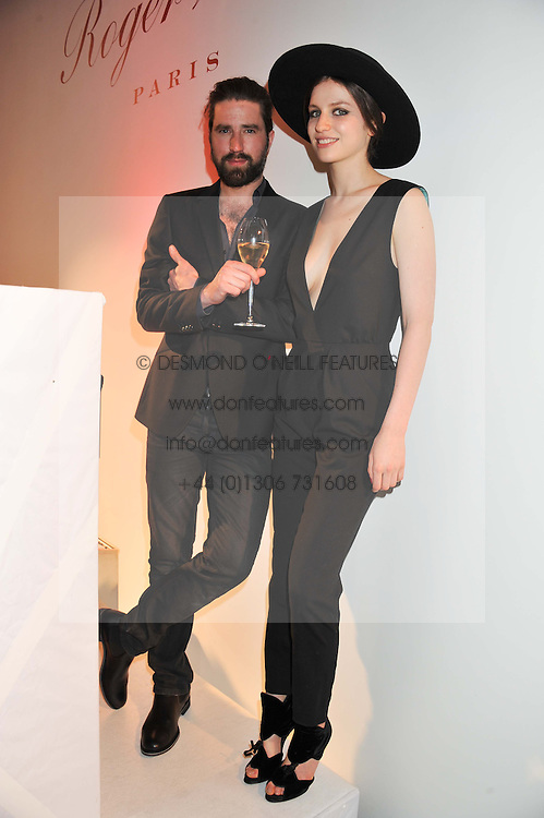 JACK GUINNESS and TALI LENNOX at a party hosted by Ines de la Frassange and Bruno Frisoni for Roger Vivier to launch the Roger Vivier book held at The Saatchi Gallery, London on 24th April 2013.