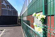 """The massive steel and mesh wire cages still cover the back yards and gardens of the Bombay Street homes pictured on Thursday, April 22, 2021. The caged houses are just one step away from their back on to the huge """"peace wall"""" on the Shankill side. A resident Pauline Murphy 56, mother of four who didn't want to be photographed said that she is still living in the place she is so attached to, adding that she would not want to see the peace wall come down or the cages removed. (Photo/ Vudi Xhymshiti)"""