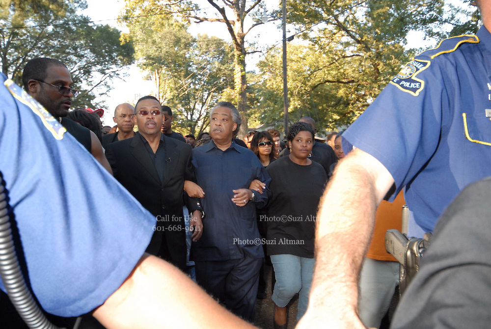 Louisiana State police walk hand in hand in front of Rev. Al Sharpton and Michale Baisden and Mrs. NBell Mychal bells mother ,right,,organizers of the Jena Freedom march as they walk to the Jena High School Thursday Sept. 20,2007.(photoSuziAltman)