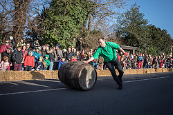 © Licensed to London News Pictures. 26/12/2016. Grantchester, UK. 'Rollers' compete in the annual Boxing Day barrel rolling race in Grantchester village, Cambridgeshire. There are four legs to the erratic relay race in which the team with the fastest time wins. Photo credit: Rob Pinney/LNP