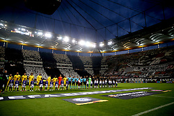 A general view of the players as they line up on the pitch ahead of the UEFA Europa League Semi final, first leg match at The Frankfurt Stadion, Frankfurt.