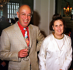 MR DAVID SPANIER and his wife SUZY MENKES, at a party in London on 15th July 1999.MUG 65 2olo