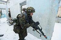23 FEB 2013, LETZLINGEN/GERMANY:<br /> Panzergrenadier des Panzergrenadierbattalions 212 mit AGDUS, Ausbildungsgeraet Duellsimulator, und Gewehr G36, waehrend einer Gefechtsuebung im abgesessenen Kampf im Winter, Gefechtsuebungszentrum Heer, Truppenuebungsplatz Altmark<br /> IMAGE: 20130223-01-056<br /> KEYWORDS: Gefechtsübung, Schnee, Gefechtsübungszentrum, Bundeswehr, Heer, Armee, Soldat, Soldaten, Militaer, Militär, Haeuserkampf, Häuserkampf, Ortskampf, Military Operations in Urban Terrain