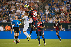 July 19, 2017 - Philadelphia, Pennsylvania, U.S - United States of America forward CLINT DEMPSEY (28) heads the ball away from El Salvador defender ALEXANDER LARêN (13) while United States of America midfielder DARLINGTON NAGBE (25) looks on during CONCACAF Gold Cup 2017 quarterfinal action at Lincoln Financial Field in Philadelphia, PA.  USA  defeats El Salvador 2 to 0. (Credit Image: © Mark Smith via ZUMA Wire)