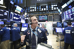 February. 6, 2018 - New York, New York, U.S. - Traders work at the New York Stock Exchange in New York. U.S. stocks closed higher after a volatile trading session on Tuesday. The Dow Jones Industrial Average added 567.02 points, or 2.33 percent, to 24,912.77. The S&P 500 increased 46.20 points, or 1.74 percent, to 2,695.14. The Nasdaq Composite Index was up 148.36 points, or 2.13 percent, to 7,115.88. (Credit Image: © Wang Ying/Xinhua via ZUMA Wire)