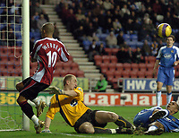 Photo: Paul Greenwood.<br />Wigan Athletic v Sheffield United. The Barclays Premiership. 16/12/2006. Wigan keeper Chris Kirkland and defender Fitz Hall combine to deny Sheffields Danny Webber