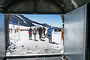 """Jungfraujoch """"Top of Europe"""" is the highest railway station in Europe (3454 meters elevation). Here, visitors can admire a high-Alpine wonderland from platforms atop the Aletsch Glacier or carved inside, in the Ice Palace. Jungfraujoch is a col at 3466 m between the peaks of Jungfrau and Mönch in the Bernese Alps, on the boundary between the cantons of Bern and Valais, halfway between Interlaken and Fiesch, in Switzerland, Europe. Engineering this dramatic cog-wheel railway required 16 years (1898-1912) to carve through the Eiger and Mönch for 7 kilometers (4.3 mi), with gradients of up to 25%. Kleine Scheidegg entry station can be reached by trains from Grindelwald and Lauterbrunnen. The ride from Kleine Scheidegg to Jungfraujoch takes 50 minutes including stops at Eigerwand and Eismeer viewing portals. Downhill return takes just 35 minutes. Jungfraujoch hosts an important station of Global Atmosphere Watch (GAW), plus the Sphinx Observatory for astronomy at 3571 meters or 11,716 feet. The Swiss Alps Jungfrau-Aletsch region is honored as a UNESCO World Heritage Site."""