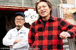 Ken Kentaro at his Hot Chop Speed Shop with his friend, mechanic Kazuhiro Takahashi. Kyoto, Japan. Friday, December 7, 2018. Photography ©2018 Michael Lichter.