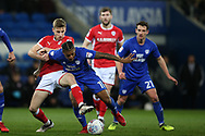 Kadeem Harris of Cardiff City © is tackled by Joseph Williams of Barnsley (l). EFL Skybet championship match, Cardiff city v Barnsley at the Cardiff city stadium in Cardiff, South Wales on Tuesday 6th March 2018.<br /> pic by Andrew Orchard, Andrew Orchard sports photography.