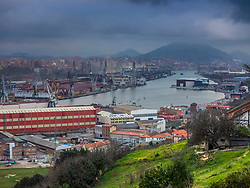 Wharf, river and stormy weather at Ria of Bilbao, Basque Country, Biscay, Spain, Europe