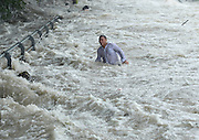 TAIPEI, CHINA - SEPTEMBER 28: (CHINA OUT, TAIWAN OUT) <br /> <br />  Spectators are swept by huge waves brought by typhoon Dujuan while watching tides of Qiantang River at a dike on September 29, 2015 in Hangzhou, Zhejiang Province of China. Typhoon Dujuan made landfall in the coastal city of Putian in Fujian province on Tuesday morning.©Exclusivepix Media