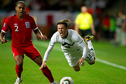 Glen Johnson of England vs Zlatko Dedic of Slovenia during the 2010 FIFA World Cup South Africa Group C Third Round match between Slovenia and England on June 23, 2010 at Nelson Mandela Bay Stadium, Port Elizabeth, South Africa.  (Photo by Vid Ponikvar / Sportida)