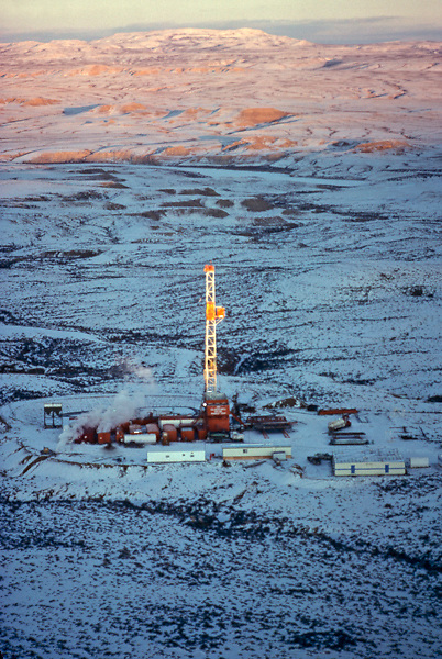 Stock photo of an on-shore rig in a snowy field