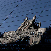 Reflection of an old building on a new one.