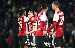 Brentford's Romaine Sawyers (left) and Lewis Macleod celebrate after the final whistle during the Skybet Championship match at The Hawthorns, West Bromwich.
