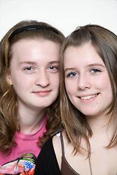 Portrait of teenage girls smiling,