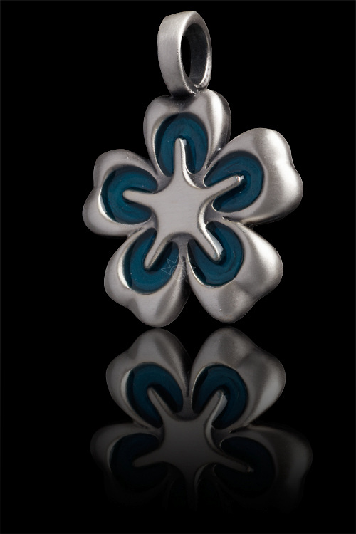 Studio photograph of a pewter pendant shot for Bico Pacific.