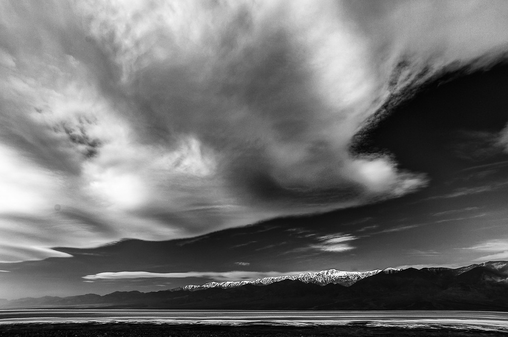 Approaching dust storm, Badwater Basin, lowest elevation in the United States −282 feet (−86.0 m), morning clouds, April, Telescope Peak 11,043 feet (3,366 m) in the distance, Panamint Range, Death Valley National Park, California, USA