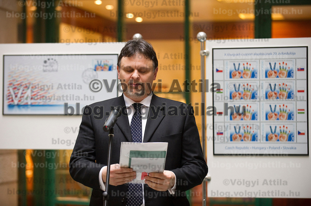 Gergely Domongos Horvath president of Hungarian Post introduces a stamp commemorating the  20th anniversary of the founding of the Visegrad Four group in Budapest, Hungary on February 15, 2011. ATTILA VOLGYI