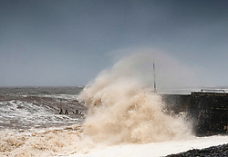 © Licensed to London News Pictures. 4/10/2020. Aberaeron, UK. Storm Alex continues to whip up the waves at South Beach in Aberaeron in West Wales. The UK has been feeling the effects of Storm Alex for a few days with high winds and heavy prolonged rain.  Photo credit: Andrew Chittock/LNP