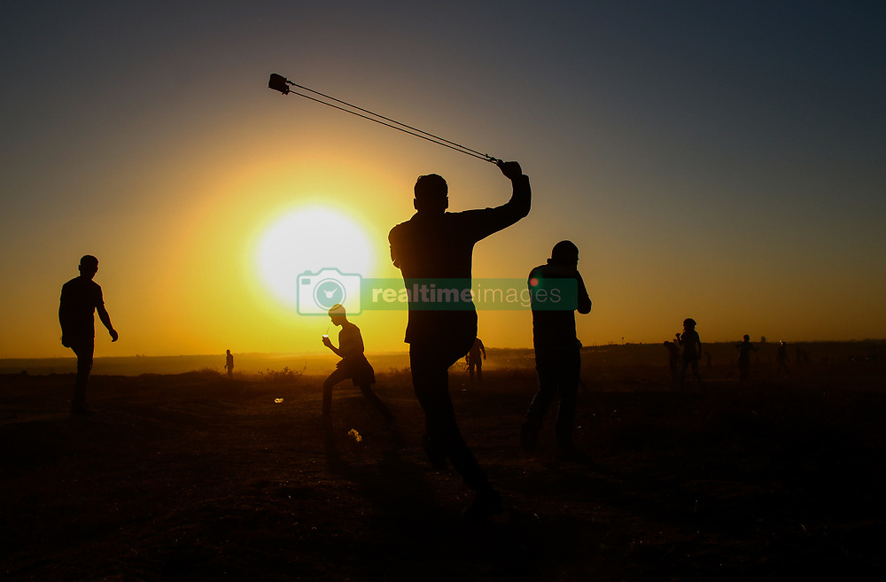 November 2, 2018 - Palestinian protesters clash with the Israeli army near the fence in the  Abu Safiy area east of Jabalia in the northern Gaza Strip during the Great March of Return rally. Since March 2018 thousands of Gaza demonstrators have gathered every Friday along the border in protest against the Israeli siege on Gaza and in support of the right of Palestinian refugees to return the land lost around the founding of Israel in 1948. (Credit Image: © Ahmad Hasaballah/IMAGESLIVE via ZUMA Wire)