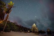 Night shots on the beach at Anibare district. Coral pinnacles such as these ones are broken down into pebbles to be used as building material for foundations, especially in the Pacific region. This is part of the secondary mining on Nauru...Nauru, officially the Republic of Nauru is an island nation in Micronesia in the South Pacific.  Nauru was declared independent in 1968 and it is the world's smallest independent republic, covering just 21 square kilometers..Nauru is a phosphate rock island and its economy depends almost entirely on the phosphate deposits that originate from the droppings of sea birds. Following its exploitation it briefly boasted the highest per-capita income enjoyed by any sovereign state in the world during the late 1960s and early 1970s..In the 1990s, when the phosphate reserves were partly exhausted the government resorted to unusual measures. Nauru briefly became a tax haven and illegal money laundering centre. From 2001 to 2008, it accepted aid from the Australian government in exchange for housing a Nauru detention centre, with refugees from various countries including Afghanistan and Iraq..Most necessities are imported on the island..Nauru has parliamentary system of government. It had 17 changes of administration between 1989 and 2003. In December 2007, former weight lifting medallist Marcus Stephen became the President.