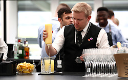 Staff at the Theatre @ The Festival restaurant mixing drinks