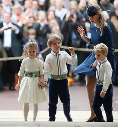 Lady Louise Mountbatten-Windsor escorts the bridesmaids and page boys, including Prince George (right), as they arrive for the wedding of Princess Eugenie to Jack Brooksbank at St George's Chapel in Windsor Castle.