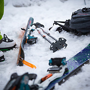 Tyler Hatcher preps to skin into the Cascade backcountry during a winter storm.