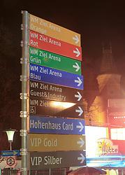 30.01.2013, Schladming, AUT, FIS Weltmeisterschaften Ski Alpin, Schladming 2013, Vorberichte, im Bild ein Wegweiser vor dem Rathaus und dem Würstelstand Heiße Hütte am 30.01.2013 // destination boards in front of the town hall on 2013/01/30, preview to the FIS Alpine World Ski Championships 2013 at Schladming, Austria on 2013/01/30. EXPA Pictures © 2013, PhotoCredit: EXPA/ Martin Huber