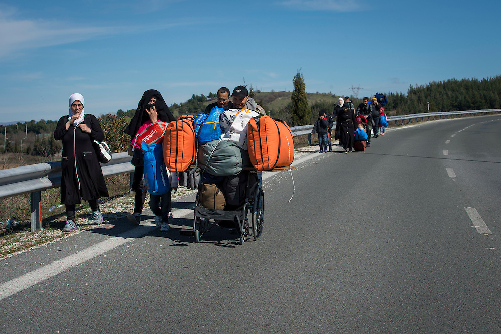 March 5, 2016 - Idomeni, Greece: Syrian regugees on the way to the make shift camp at the  Idomeni border crossing in Greece. 13,000 refugees are stuck here after Macedonia closed the border. New arrivals come in every day, making living conditions more and more difficult, so that the local government asked the emercency state was declared . (Steven Wassenaar/Polaris)