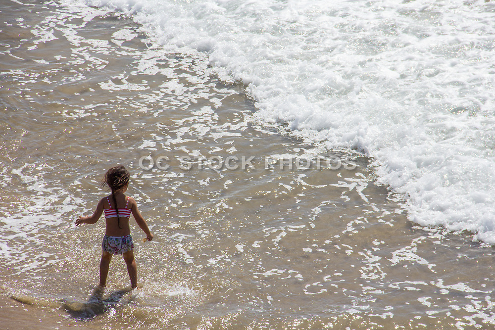 Little Girl Playing in the Ocean at Hermosa Beach