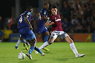 AFC Wimbledon defender Deji Oshilaja (4) dribbling during the EFL Carabao Cup 2nd round match between AFC Wimbledon and West Ham United at the Cherry Red Records Stadium, Kingston, England on 28 August 2018.