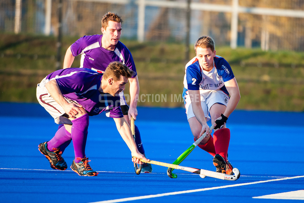 Andrew Round is tackled by a Crostyx player. Crostyx v Bishops Stortford - East League Division 1, Lee Valley Hockey & Tennis Centre, London, UK on 13 December 2014. Photo: Simon Parker