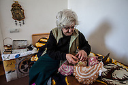 Josephine from Aleppo, Syria in her home in Darpnik, Armenia. After leaving Syria due to war, and 'returning' to her homeland, Josephine fears about the future for Christians in Syria, and says she intends to stay in Armenia.