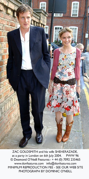 ZAC GOLDSMITH and his wife SHEHERAZADE, at a party in London on 6th July 2004.PWW 96
