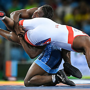The disputed move that led to two points and the bronze medal victory to United States wrestler J'den Cox (top) against Cuba's Reineris Salas on a 3-1 decision on Saturday at Carioca Arena 2 during the 2016 Summer Olympics Games in Rio de Janeiro, Brazil.