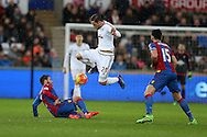 Gylfi Sigurdsson of Swansea city jumps over Yohan Cabaye of Crystal Palace. Barclays Premier league match, Swansea city v Crystal Palace at the Liberty Stadium in Swansea, South Wales on Saturday 6th February 2016.<br /> pic by Andrew Orchard, Andrew Orchard sports photography.