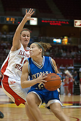04 February 2006: Melanie Boeglin eyes the goal while Kristi Cirone goes for the block. The Indiana State Sycamores shook the Illinois State Redbirds from the nest with a 75-71 Victory.  There were 3,581 fans on hand, making the audience the  2nd largest women's basketball crowd ever in Redbird Arena on Illinois State University campus in Normal Illinois.