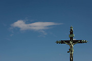A crucified Christ on the cross stands in blue sky and high cirrus cloud, a theme of heavenly and spiritual presence on a summers day, on 18th June 2016, in Montpellier, France.