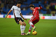 Kim Bo-Kyung of Cardiff city ® is challenged by Emmanuel Ledesma of Rotherham Utd. .Skybet football league championship match, Cardiff city v Rotherham Utd at the Cardiff city stadium in Cardiff, South Wales on Saturday 6th December 2014<br /> pic by Andrew Orchard, Andrew Orchard sports photography.