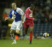 Photo: Aidan Ellis.<br /> Blackburn Rovers v AS Nancy. UEFA Cup. 13/12/2006.<br /> Rovers Jay McEveley (L) battles with Nancy's KIM