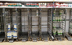 © Licensed to London News Pictures. 21/09/2021. London, UK. Empty shelves of fresh milk, just after 8am this morning in Sainsbury's, north London, Fears of food shortages grow after two of the UK's biggest Carbon Dioxide (CO2) producers halted production last week due to soaring gas prices. UK food producers and supermarkets are warning that shoppers are likely to face food shortage caused by a lack of gas could hit this week. Photo credit: Dinendra Haria/LNP
