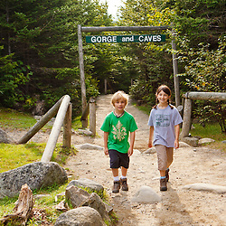 A young brother and sister at the entrance to Lost River Gorge in New Hampshire's White Mountains. North Woodstock.