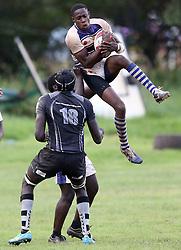 Richard Alai of Mean Machine in action against Humphrey Khayange (L) of Mwamba RFU during their Kenya Cup Tournament at Railway Club In Nairobi, on 3rd December 2016. Mwamba won 51-8. Photo/Fredrick Onyango/www.pic-centre.com (KEN)